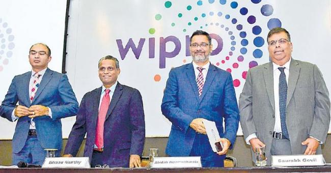 Wipro Q1 net grows 12.6 persant to Rs 2,388 cr - Sakshi