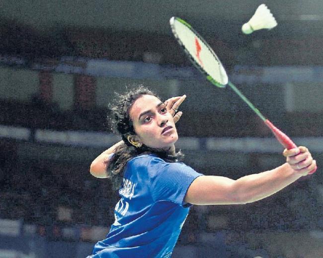 PV Sindhu, Kidambi Srikanth enter 2nd round of Indonesia Open - Sakshi