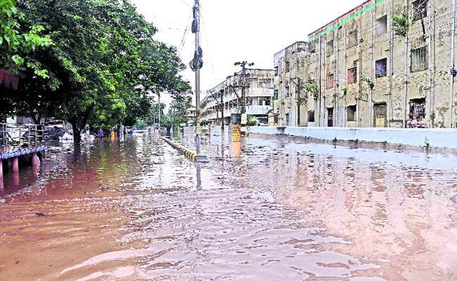 Kakinada City Drainages Are Overflow When It Rains - Sakshi