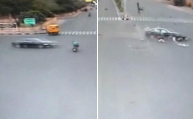 Man Flung 30 Feet As Speeding Audi Rams Bike At Intersection In Jaipur - Sakshi