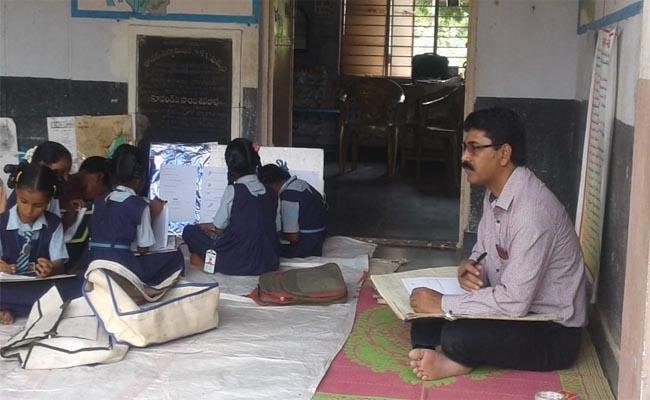 The Headmaster Sitting on the Floor and Giving Lessons - Sakshi