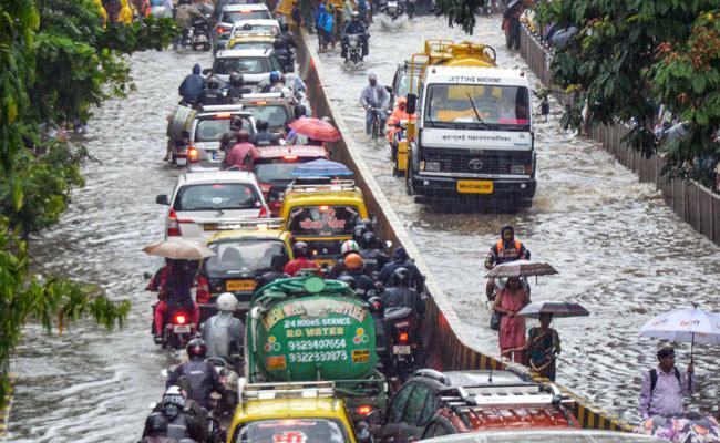 Heavy Rains Lead to Wall Collapse in Pune, Mumbai, Kalyan - Sakshi