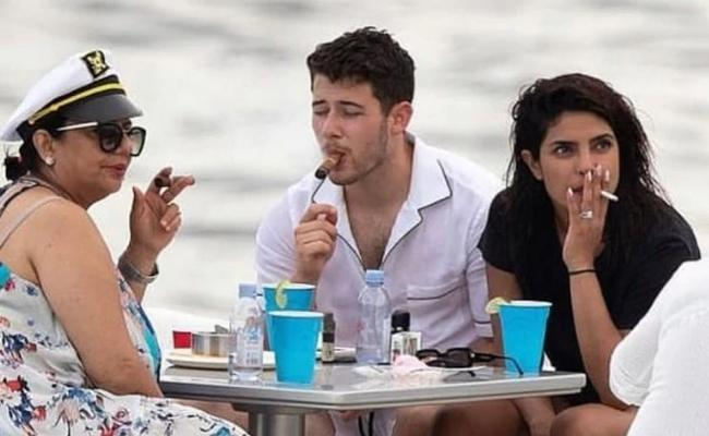 Priyanka Chopra Smokes on Yacht in Miami - Sakshi