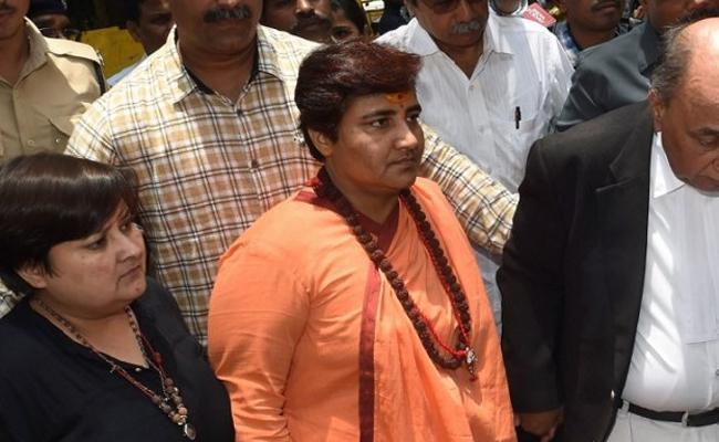 JP Nadda pulls up Sadhvi Pragya - Sakshi
