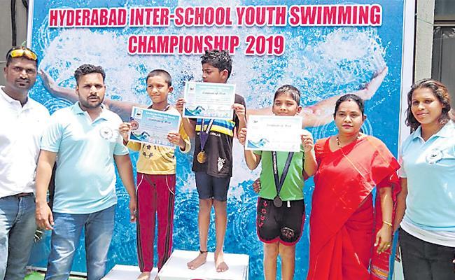 Sachin And Praharshita Got Swimming Titles - Sakshi