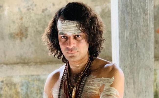 Tej Pratap Yadav Dresses Up As Lord Shiva Again Offers Prayers At Temple In Patna - Sakshi