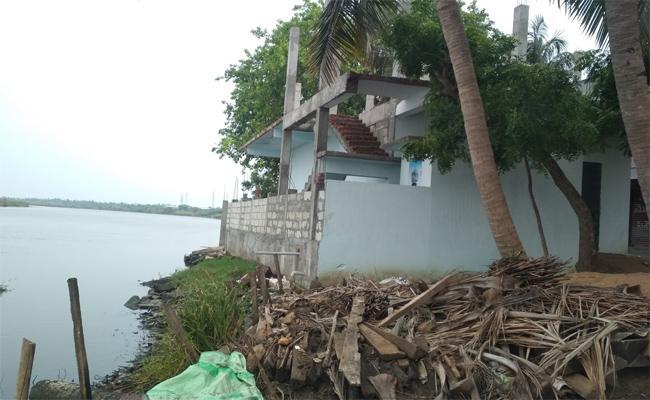 Rampant Encroachments Thrive At Upputeru River In Krishna District - Sakshi