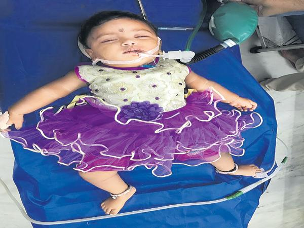 A watch battery stuck in a baby throat - Sakshi