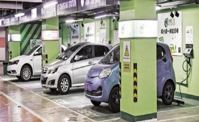 GST on EVs slashed to 5 Percent from 12 Percent - Sakshi