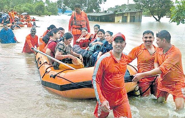 Mahalaxmi Express in flood in 17 hours - Sakshi
