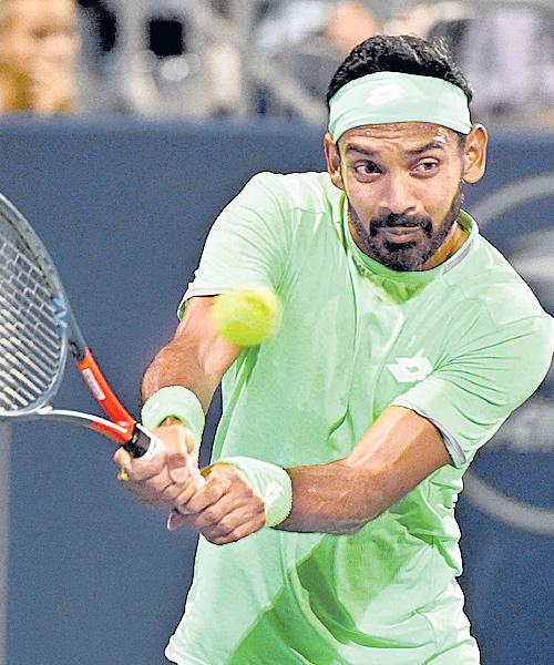 Divij And Erlich go down fighting to the Bryan twins - Sakshi