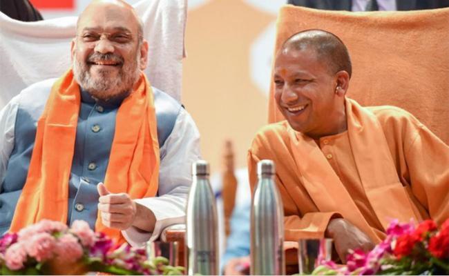 Amith Shah Praises Yogi Adithyanath In Lucknow - Sakshi