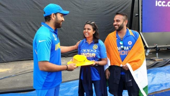 Hit by a six, fan gets signed hat from Rohit Sharma - Sakshi