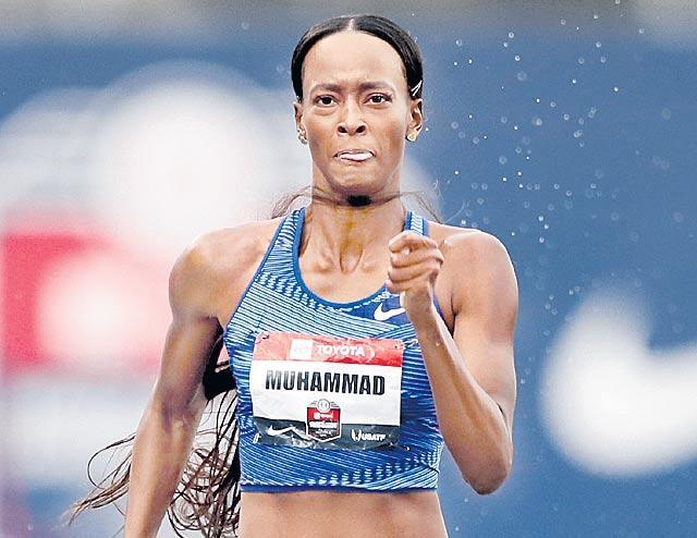 Dalilah Muhammad broke the 400m hurdles world record - Sakshi