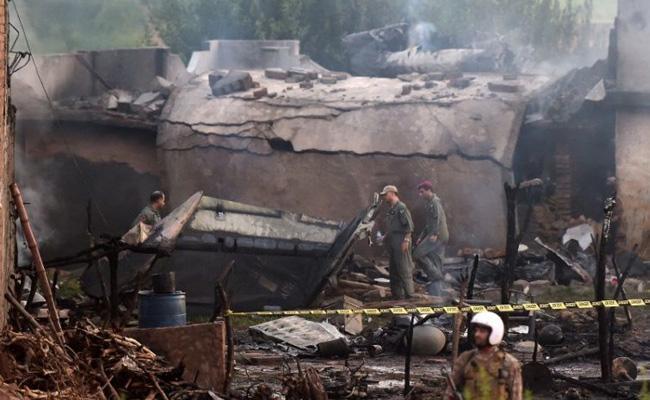 Pakistan Army Plane Crashes Into Residential Area At Rawalpindi - Sakshi