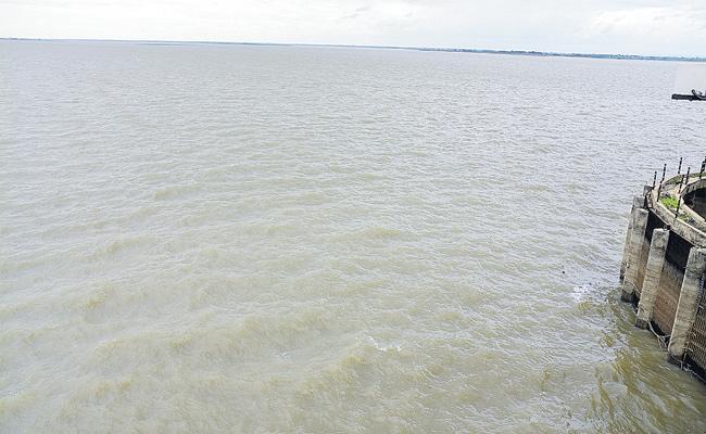 Krishna Water Release From Jurala To Srisailam Begins - Sakshi