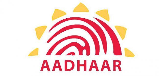 Lok Sabha passes Aadhaar and Other Laws Bill - Sakshi