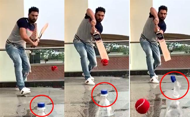 Yuvraj Singh Adds New Dimension to Bottle Cap Challenge - Sakshi