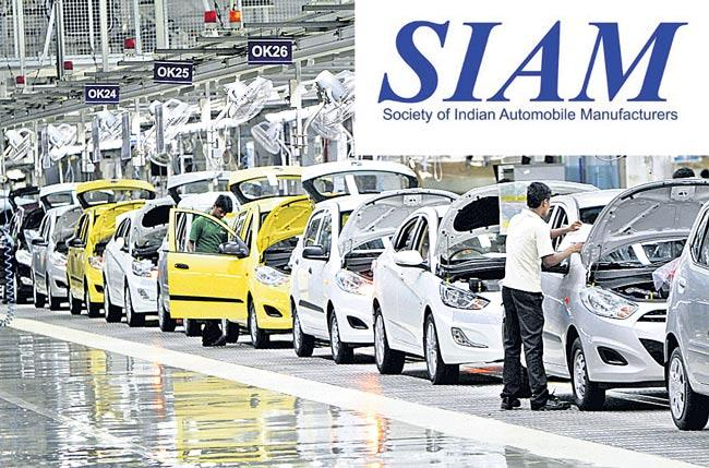 Auto companies slam brakes on production - Sakshi