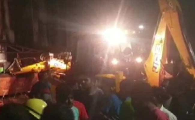 Three Storey Building Collapses In Kheda - Sakshi