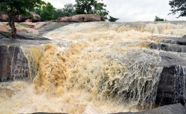Heavy Water Floods In Bhimeshwara stream In Nizamabad - Sakshi