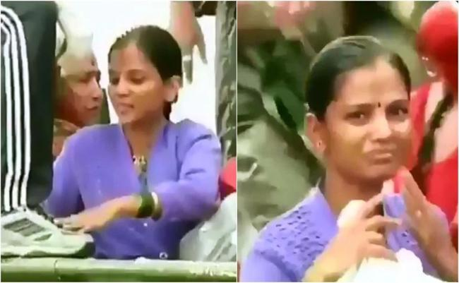 A Woman touching Army Man Feet To Show Gratitude In Maharashtra - Sakshi