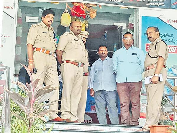 Kodela Sivaram bike showroom was sieged - Sakshi