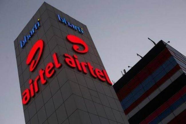 SoftBank in talks To Buy Stake In Bharti Airtel - Sakshi