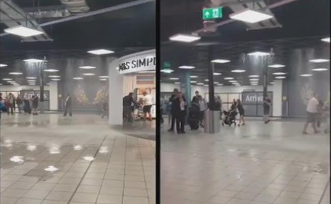 Water Pours Into Airport In London - Sakshi