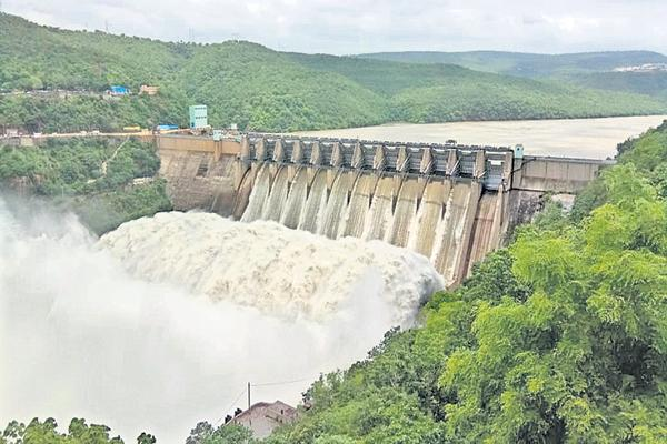 Rivers of Krishna and Godavari and Vamsadhara are Overflowing after 10 years - Sakshi