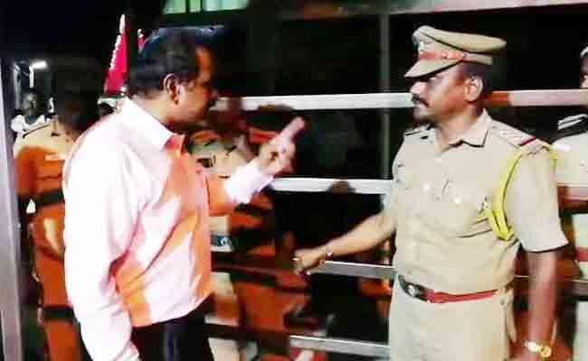 Tamil Nadu Bureaucrat Threatens Cop In Temple - Sakshi