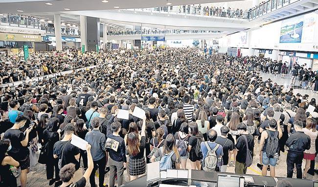 Hong Kong Airport Cancels All Flights as Protesters Swarm - Sakshi