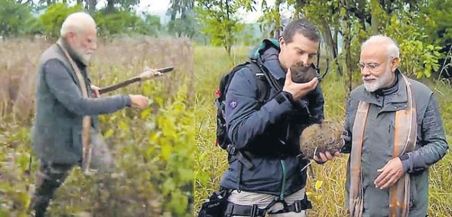 My position never goes to my head, PM Modi tells Bear Grylls - Sakshi
