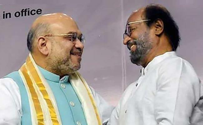 Congress Fires On Rajinikanth On Praising Modi And Amit Shah - Sakshi
