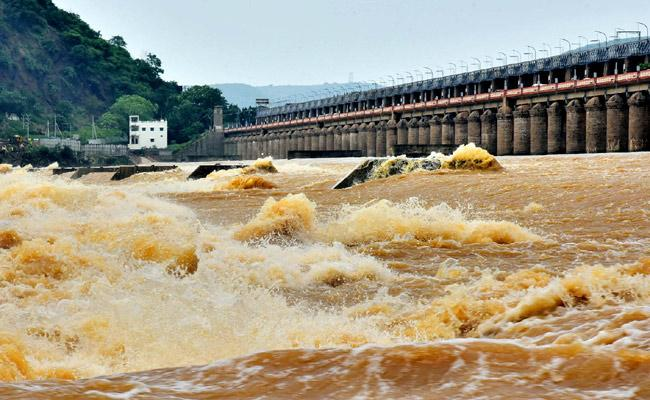 Heavy Flood Reached To Prakasam Barrage Water Release To Down - Sakshi