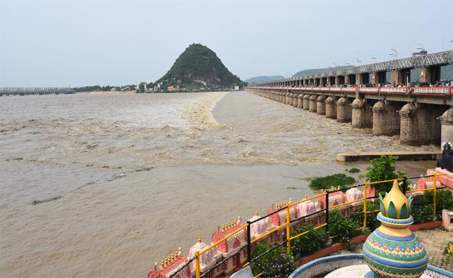 Prakasam Barrage Opens All 70 Gates Lifted To Prevent Flooding - Sakshi