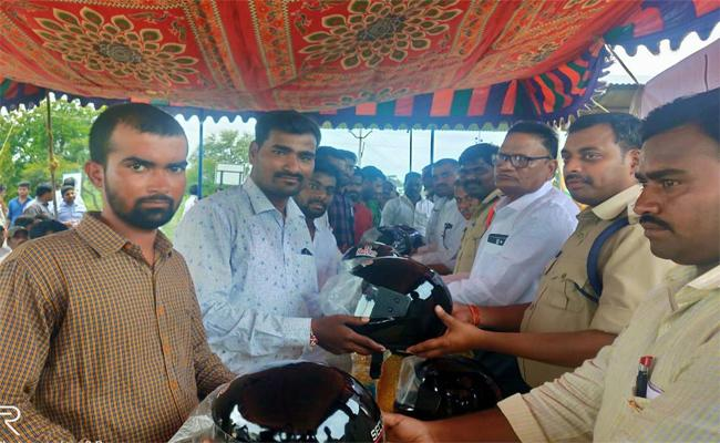 Person Distributed Helmets In Bhainsa For Road Accidents Safety Awareness  - Sakshi