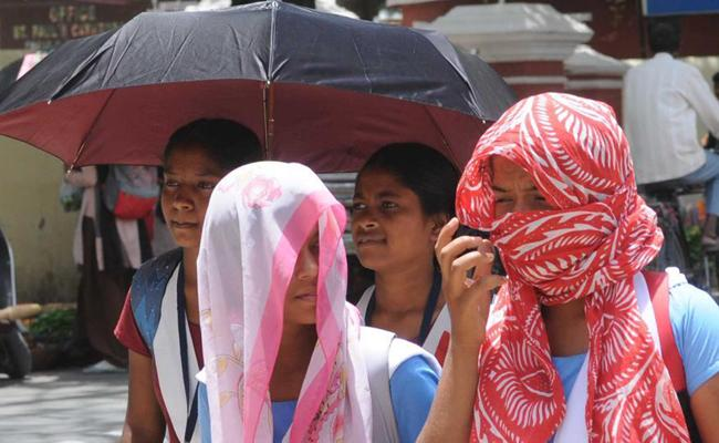 Vishakha People Trouble With Sun Heat - Sakshi