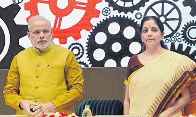 PM Modi reviews state of economy with Nirmala Sitharaman, FinMin officials - Sakshi