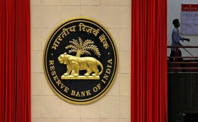 RBI may cut interest rates by 40 basis points before this fiscal-end Fitch - Sakshi