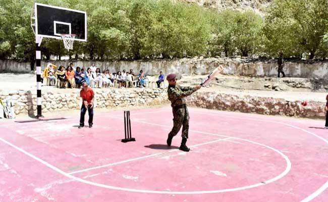 Lieutenant Colonel MS Dhoni Batting In Basketball Ground In Leh - Sakshi