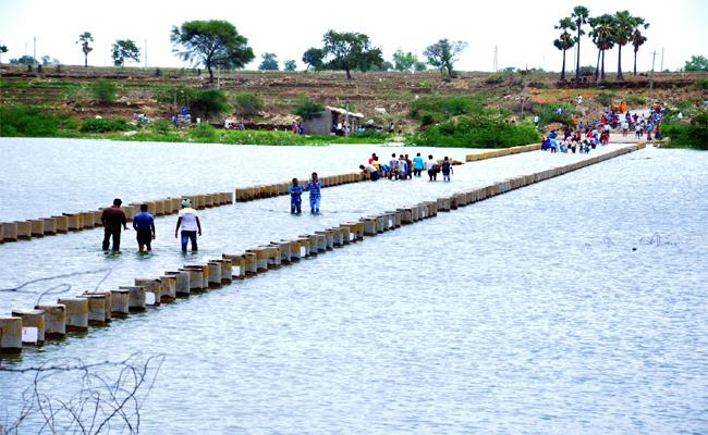 Breaches Everywhere By The Krishna River - Sakshi