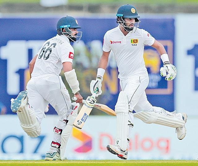 Karunaratne leads Sri Lanka victory push in Galle - Sakshi