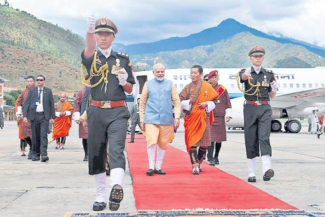 Narendra Modi cements Bhutan ties with RuPay launch - Sakshi