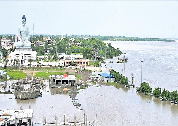 People stuck in Krishna river flood - Sakshi