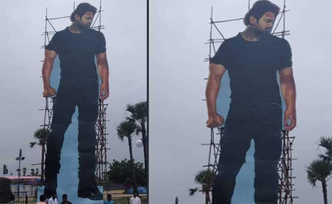 Prabhas 60 Feets Cut Out In Saaho Pre Release Event In Hyderabad - Sakshi