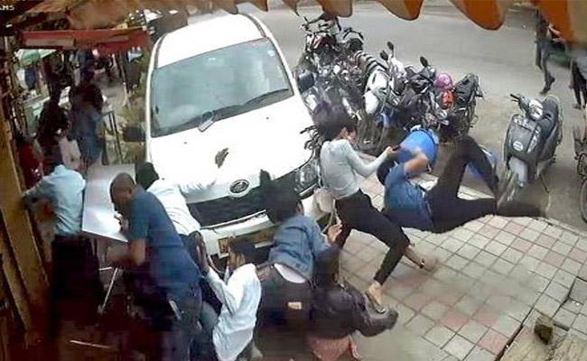 A drunk person drove his car over pedestrians - Sakshi