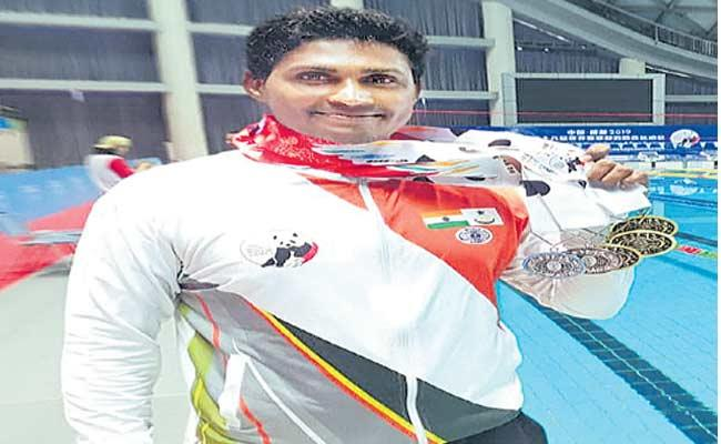 Swimmer Tulasi Chaitanya Won Six Medals In China - Sakshi