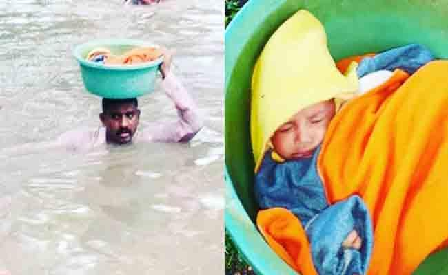 Vadodara Police Carries Child In Tub On His Head Over Floods - Sakshi