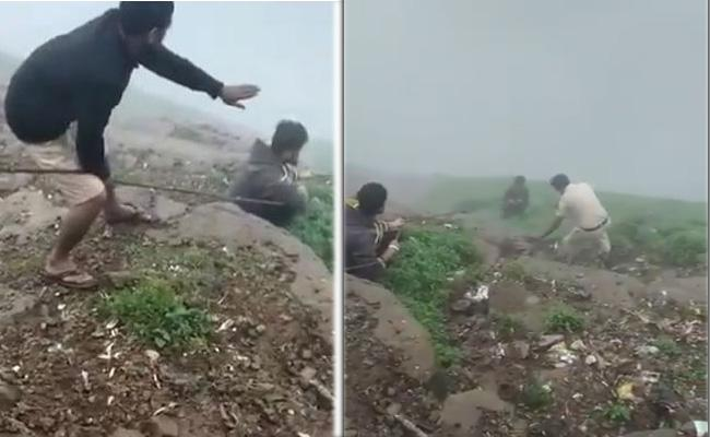 Youth Falls off Into Steep Slope While Trying To Click Selfie - Sakshi